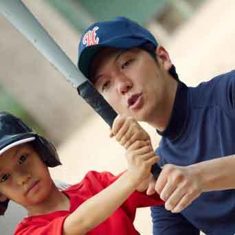野球少年とコーチ